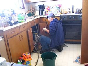 320px-Plumber_at_work